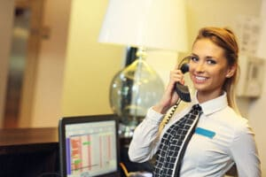 65613856 - picture of pretty receptionist at work