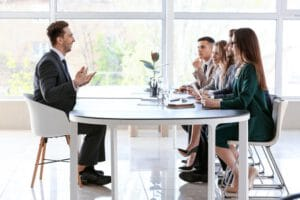 human-resources-commission-interviewing-man-office_392895-19083