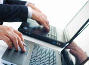 worker-communication-businesses-laptop-typist_1301-1963