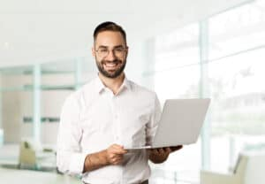 business-sucessful-businessman-working-with-laptop-using-computer-smiling-standing