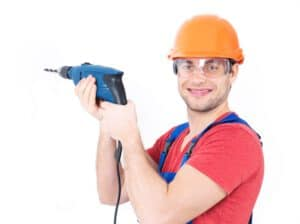 portrait-smiling-man-drilling-hole-wall_186202-3074