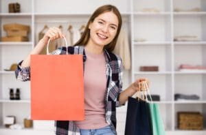 smiley-woman-being-happy-with-purchased-products_23-2148316757